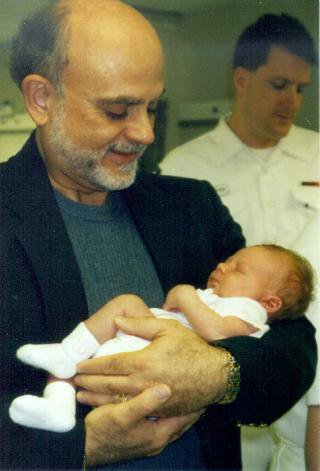 JB Symons holds his first grandchild.